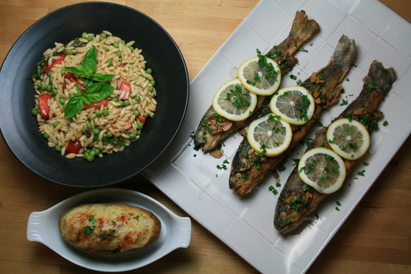 Trout almondine, orzo salad with peas and tomatoes in a balsamic vinaigrette