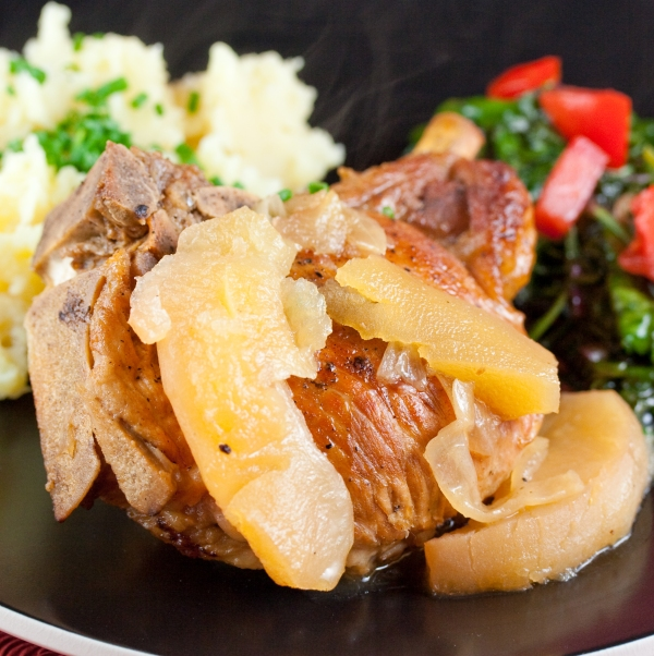 Pork Chops Stuffed with Dried Apples and Cranberries, Gorganzola, Sage & Braised in Cider with Caramelized Onions and Apples